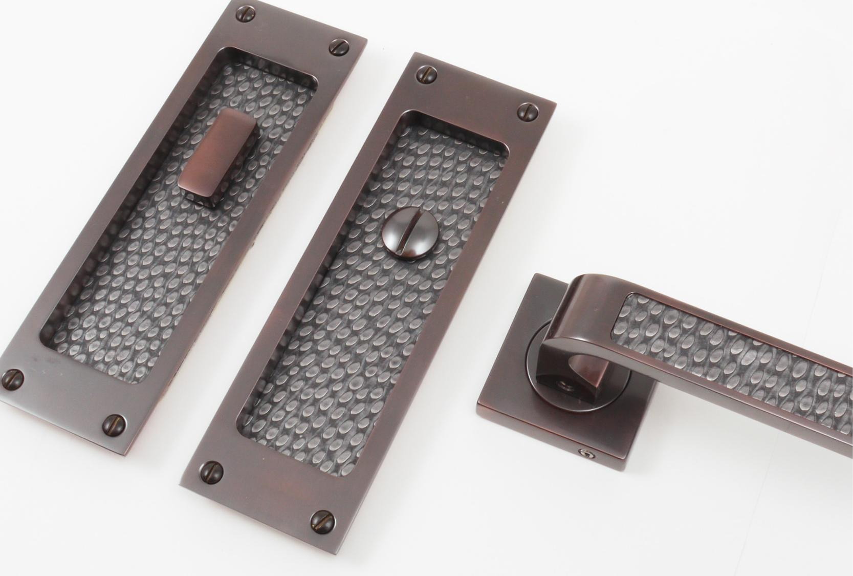 FAUX LEATHER FLUSH PULL AND DOOR LEVER